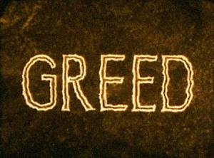greed-title-still-small